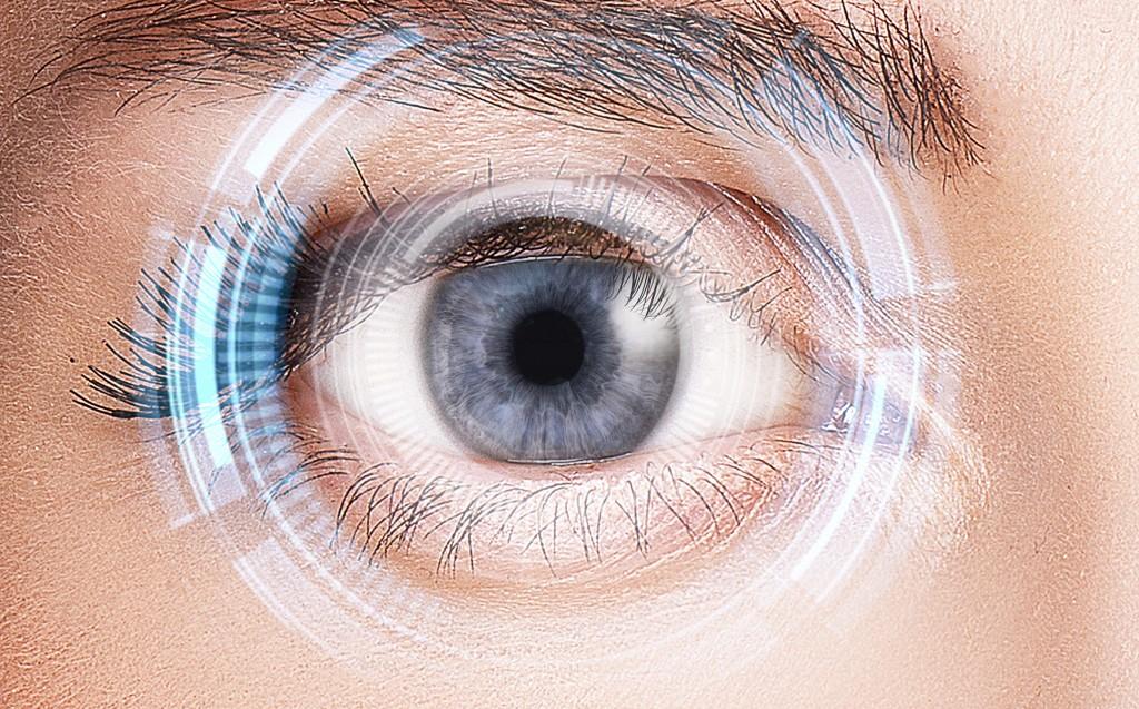 Security retina scanner on woman blue eye